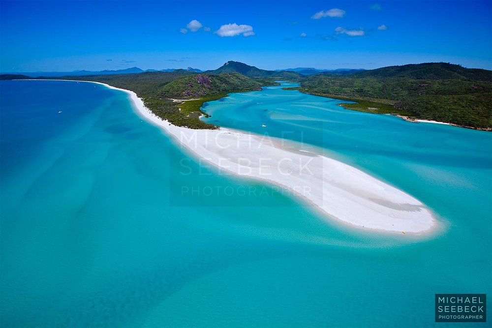 An aerial photograph of Whitehaven Beach and Cook Inlet, captured on a beautiful idyllic day.<br /> <br /> Code: LAQW0002<br /> <br /> Limited Edition Print