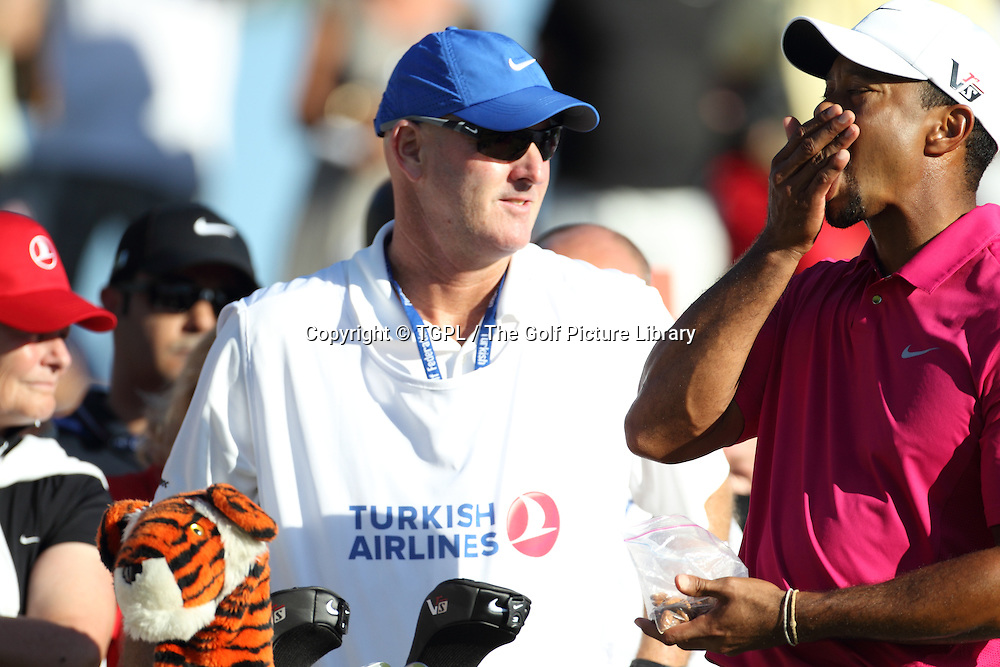 Tiger WOODS (USA) eats some nuts for energy during third round Turkish Airlines Open by Ministry of Culture and Tourism 2013,Montgomerie Course at Maxx Royal,Belek,Antalya,Turkey.