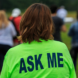 "Avondale, PA, USA - June 24, 2018: A volunteer wears an ""Ask Me"" shirt at the annual Chester County Balloon Festival at the New Garden Flying Field in Toughkenamon."