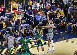 Mar 7, 2020; Morgantown, West Virginia, USA; West Virginia Mountaineers guard Jermaine Haley (10) shoots over Baylor Bears forward Freddie Gillespie (33) during the first half at WVU Coliseum. Mandatory Credit: Ben Queen-USA TODAY Sports