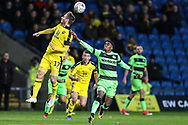 Oxford United's James Henry(17) heads the ball under pressure from Forest Green Rovers Reece Brown(10) during the The FA Cup 1st round match between Oxford United and Forest Green Rovers at the Kassam Stadium, Oxford, England on 10 November 2018.