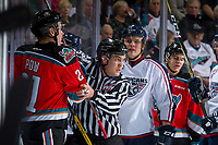 KELOWNA, CANADA - OCTOBER 27: Linesman Kevin Crowell gets between Kyle Pow #21 of the Kelowna Rockets and Mitchell Brown #5 of the Tri-City Americans on October 27, 2017 at Prospera Place in Kelowna, British Columbia, Canada.  (Photo by Marissa Baecker/Shoot the Breeze)  *** Local Caption ***