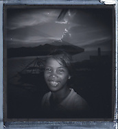Double exposure portrait of a Filipino girl looking at the camera with a big smile on her face, with an image of a pier in the background, Palawan Island, Philippines, Southeast Asia