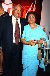 MR & MRS RAJ LOOMBA he is chairman of the Loomba Trust at a cocktail party hosted by MAC cosmetics to kick off London Fashion Week at The Hospital, 22 Endell Street London on 18th September 2005.At the event, top model Linda Evangelista presented Ken Livingston the Lord Mayor of London with a cheque for £100,000 in aid of the Loomba Trust that aims to privide education to orphaned children through a natural disaster or through HIV/AIDS.<br /><br />NON EXCLUSIVE - WORLD RIGHTS