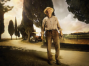 A farmer in front of the fields in Tuscany Italy.