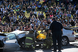 """February 17, 2016 - San Antonio, Texas, U.S. - Johnson High School students watch Wednesday February 17, 2016 during the school's """"Shattered Dreams"""" event. The mock accident event features active first responders attending a staged head on collision resulting in death and injuries caused by alcohol consumption and distracted driving. According to the San Antonio Fire Department's public information officer Deborah Foster, the event has been staged at various area schools since 1998. """"This brings home the message that drinking and driving don't mix,"""" Foster said. Students who witness the accident scene will attend a mock funeral the following day. (Credit Image: © John Davenport/San Antonio Express-News/ZUMAPRESS.com)"""
