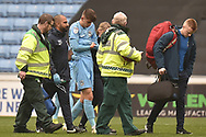 Coventry City defender Tom Davies  (5) leaves the field, injured during the EFL Sky Bet League 1 match between Coventry City and Bristol Rovers at the Ricoh Arena, Coventry, England on 7 April 2019.