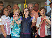 Oregon Gov. Kate Brown (with thumbs up) and other dignitaries pose in the doorway of the a MAX train as Trimet opened the new Portland-Milwaukie MAX Orange line on Sept. 12, 2015. With the opening go the line came the first official use of the new Tilikum Crossing, Bridge of the People. Randy L. Rasmussen/Staff