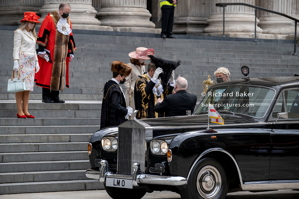 William Russell, the 692nd Lord Mayor of London, removes his tricorn hat alongside official dignitaries outsiide the steps of St Paul's Cathedral after the private 'The Lord Mayor's Service of Reconciliation And Hope' function, on 22nd June 2021, in London, England.