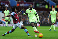 Yaya Toure of Manchester city ® passes under pressure from Carlos Sanchez of Aston Villa. .Barclays Premier league match, Aston Villa v Manchester city at Villa Park in Birmingham, Midlands  on Sunday 8th November 2015.<br /> pic by  Andrew Orchard, Andrew Orchard sports photography.