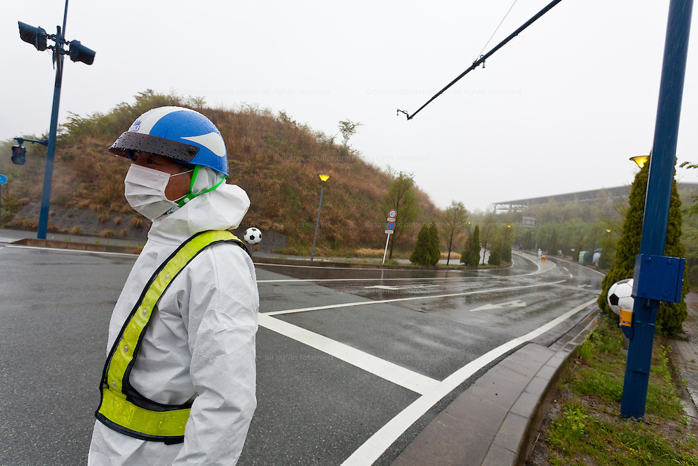 Police and securiy at the border of the 20 Kilimetre exclusion zone near J-Village in Iwaki, Fukushima, Japan. Thursday May 3rd 2012. J-Village is the centre of reconstruction and decommissioning efforts at the Daichi Nuclear Power station that was damaged in the March 11th 2011 earthquake and tsunami