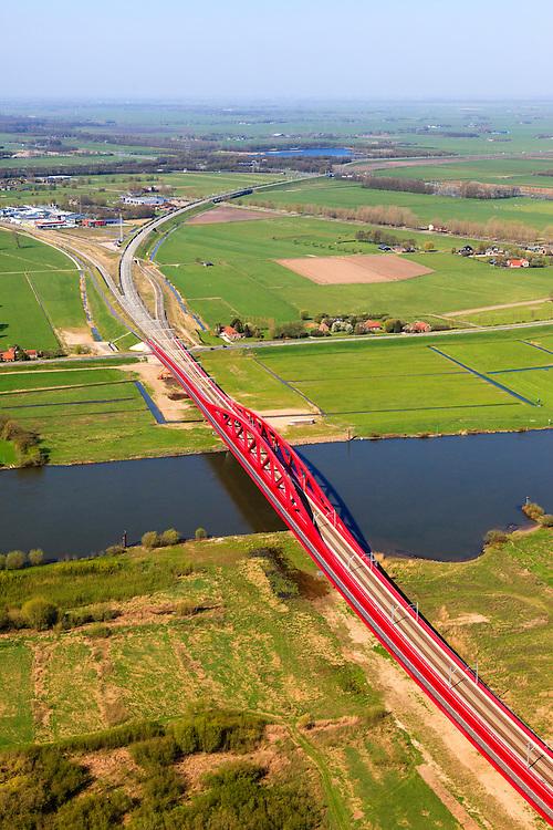 Nederland, Gelderland - Overijssel, Hattem, 01-05-2013; IJsselbrug, spoorbrug bij Hattem voor de Hanzelijn. Splitsing van de spoorlijn naar Kampen en Amersfoort.<br /> De 'Hanzeboog' is ontworpen door  Quist Wintermans Architecten.<br /> The red railway bridge Hanzeboog (Hanseatic arch) over the IJssel near Zwolle, has been designed by Quist Wintermans Architects. <br /> luchtfoto (toeslag op standard tarieven);<br /> aerial photo (additional fee required);<br /> copyright foto/photo Siebe Swart