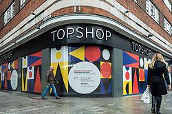 © Licensed to London News Pictures. 30/07/2021. LONDON, UK.  People pass an empty Topshop store on Oxford Street. According to a report from the British Retail Consortium (BRC) and Local Data Company, one in seven shops across Britain is empty as retailers continue to suffer the effects of the Covid pandemic on footfall and customers move to online shopping.  There is a sharp divide between the south of England, including London, with lower vacancy rates compared to the north of the country.  Photo credit: Stephen Chung/LNP