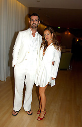 RUPERT EVERETT and JADE JAGGER at a party at The Sanderson Hotel on 9th June 2005 to launch 50 Gramercy Park North - Ian Schrager's show-stopping new residential project in New York City. Schrager, with the help of UK architect John Pawson, is building a block of 23 original residences facing Gramercy Park, inbetween two blocks of the Gramercy Park Hotel. <br /><br />NON EXCLUSIVE - WORLD RIGHTS