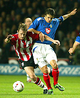 Photograph: Scott Heavey.<br />Southampton v Portsmouth City. Carling Cup.<br />02/12/2003.<br />Brett Ormerod burst throught the Pompey defence