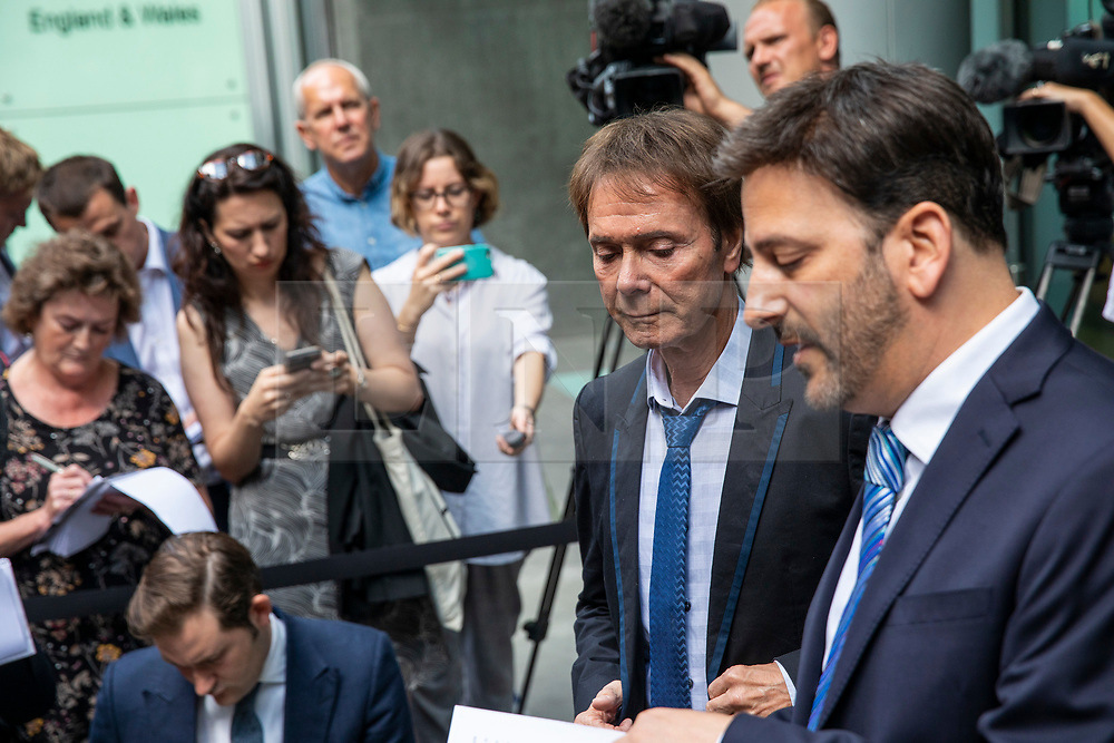 © Licensed to London News Pictures. 18/07/2018. London, UK. SIR CLIFF RICHARD (2-R) with his lawyer (R) as he leaves the Rolls Building of the High Court in London after winning his claim for damages against the BBC for loss of earnings. The 77-year-old singer sued the corporation after his home in Sunningdale, Berkshire was raided following allegations of sexual assault made to Metropolitan Police. Photo credit: Rob Pinney/LNP