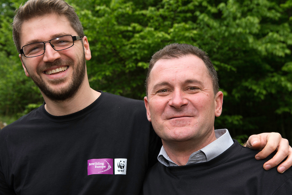 Adrian Hagatis WWF Romania and Petru Vela, the Mayor of Armenis, at the release of European bison, Bison bonasus, in the Tarcu mountains nature reserve, Natura 2000 area, Southern Carpathians, Romania. The release was actioned by Rewilding Europe and WWF Romania in May 2014.