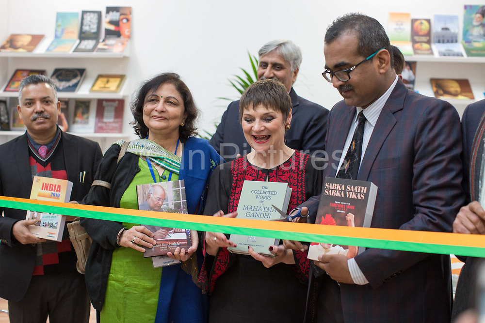 Jacks Thomas, director of the London Book Fair, with members of the Indian High Commission during day one of the London Book Fair at Kensington Olympia on the 12th March 2019 in London in the United Kingdom. Ribbon cutting to open the Govenment of Indias book stand.