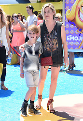 July 23, 2017 - Westwood, California, U.S. - Kathleen Robertson and William Robert Cowles arrives for the premiere of the film 'The Emoji Movie' at the Regency Village theater. (Credit Image: © Lisa O'Connor via ZUMA Wire)