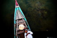 Bird's eye view of a man sleeping in his barge, Hoi An, Vietnam, Southeast Asia