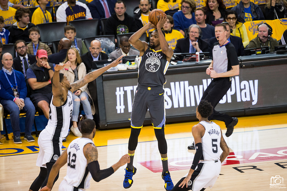 Golden State Warriors forward Kevin Durant (35) shoots a jump shot against the San Antonio Spurs during Game 2 of the Western Conference Quarterfinals at Oracle Arena in Oakland, Calif., on April 16, 2018. (Stan Olszewski/Special to S.F. Examiner)