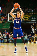 WACO, TX - JANUARY 7: Brannen Greene #14 of the Kansas Jayhawks brings the ball up court against the Baylor Bears on January 7, 2015 at the Ferrell Center in Waco, Texas.  (Photo by Cooper Neill/Getty Images) *** Local Caption *** Brannen Greene
