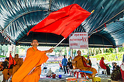 08 MAY 2013 - BANGKOK, THAILAND:  Buddhist monks applaud Red Shirt speakers during a protest at the constitutional court. A splinter group of the Red Shirts, Thai supporters of exiled Prime Minister Thaksin Shinawatra, have besieged the Thai Constitutional Court for the last three weeks calling for the resignation of the justices, who have indicated they might oppose a proposed constitutional reform which would grant amnesty to people convicted of political crimes since 2007. This would probably include Thaksin. The justices have refused to step down. Wednesday the protesters moved their protest to the Thai Parliament, which is largely powerless to intervene.  PHOTO BY JACK KURTZ