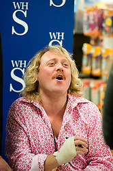 "Whith his right hand bandaged Leigh Francis in character as TV JUICE host Keith Lemon poses for photos with fans while signing copies of his new book. 'Keith Lemon: The Rules""  when he stopped in at WHSmith Meadowhall shopping centre in Sheffield. The event scheduled for 5:00 - 5:30 was so popular that Keith started signing early and didn't finish until 7:05pm as well as sales of the book being restricted.  .1st November 2011. Image © Paul David Drabble"