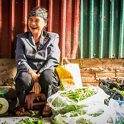A elderly Hanoian woman with black teeth is offering her veggies not too far from Hanoi city center. The custom of blackaning teeth was used for young tribal women, when they came of marrying age. It was considered a sign of beauty. Nowadays, this tradition is on a stead decline, if not vanished already.