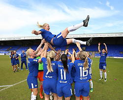 Chelsea Ladies captain Katie Chapman is thrown into the air by her team mates after her last game during the FA WSL One match at Prenton Park, Tranmere.