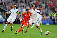 Gareth Bale of Wales holds off Israel's Orel Dgani (r). Euro 2016 qualifying match, Wales v Israel at the Cardiff city stadium in Cardiff, South Wales on Sunday 6th Sept 2015.  pic by Andrew Orchard, Andrew Orchard sports photography.