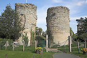 Castle walls and entrance towers Bungay castle, Suffolk, England. On high ground, virtually surrounded by the Waveney and a site of earlier fortifications, Hugh Bigod, as feudal lord, built a massive Norman keep in 1165. From this site he terrorised the local Saxons and at times illegally occupied the castles at Norwich and Orford. In 1174 he supported Henry II 's rebellious sons in armed insurrection, which ended in surrender of the Castle to the King's forces and the payment of 1,000 Marks for his disloyalty. <br /> <br /> A second castle was built by Roger Bigod in 1294, which protected the town with curtain walls and provided the famous twin towers of the gate house which remain today.