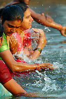 """India, Nasik, 2006. In India, """"puja'"""" or cleansing, is an integral part of Hindu religious life. Pilgrims regard the waters of the Godavari to be sacred."""