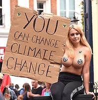 topless Extinction Rebellion protestor St Martin's Lane london photo by Krisztian Elek