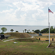 SULLIVAN'S ISLAND, South Carolina - The view out over the entrance to Charleston Harbor from the Harbor Entrance Control Post/Harbor Defense Command Post operational in 1944-45. From this camouflaged concrete observation post, Army and Navy personnel kept a round-the-clock vigil to protect Charleston Harbor. Fort Moultrie is part of the Fort Sumter National Monument at the entrance to Charleston Harbor in South Carolina. The fort has played a crucial role in defending the harbor from the time of the Revolutionary War through World War II. During that time it has undergone multiple upgrades, from the original palmetto log walls to the newer heavily fortified earthen bunkers.