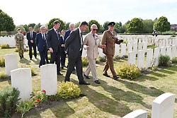 The Prince of Wales and Vice Admiral Sir Timothy Laurence during a wreath laying ceremony at the Artillery Wood Cemetery in Ypres, Belgium, to mark the centenary of Passchendaele.
