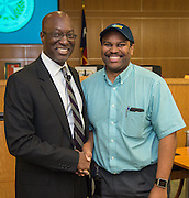 Houston ISD Interim Superintendent presents Prosper Williams with a Team HISD cap during a central office staff meeting, May 17, 2016.