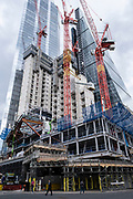 View looking up at the construction site for the latest skyscraper in the City of London at 8 Bishopsgate on 13th April 2021 in London, United Kingdom. The City of London is a city, county and a local government district that contains the historic centre and the primary central business district CBD of London, and is now known for being full of skyscrapers.