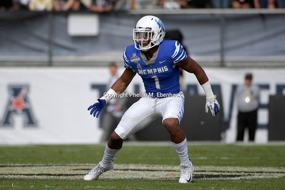 Memphis running back Tony Pollard (1) sets up for a play during the first half of the American Athletic Conference championship NCAA college football game against Central Florida Saturday, Dec. 2, 2017, in Orlando, Fla. (Photo by Phelan M. Ebenhack)