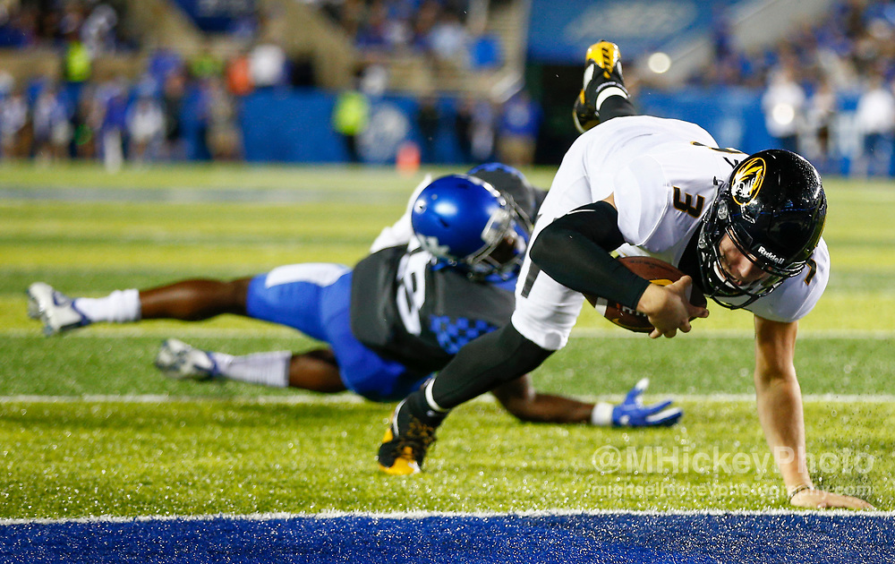 LEXINGTON, KY - OCTOBER 07: Drew Lock #3 of the Missouri Tigers dives for a touchdown after escaping the tackle attempt from Darius West #25 of the Kentucky Wildcats at Commonwealth Stadium on October 7, 2017 in Lexington, Kentucky. (Photo by Michael Hickey/Getty Images) *** Local Caption *** Drew Lock; Darius West