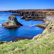 Arnarstapi is a beautiful fishing hamlet on the southern side of Iceland's Snæfellsnes Peninsula. Deep blue waters, columnar basalt, ravines and grottoes surround the small harbor. The cliffs along the coastline are occupied by a myriad of seabirds who nest in the area.