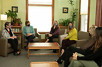 Jacqui Abikoff -Horizons, Senator Jeanne Shaheen, Carmen Lorentz -Lakes Region Community Development and Daisy Pierce -Navigating Recovery talk with counselors and residents from the Compass House on Tuesday afternoon.  (Karen Bobotas Photo/for The Laconia Daily Sun)