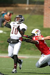 20 October 2012:  Nate Palmer gets to Kierra Harris just as Harris passes the ball during an NCAA Missouri Valley Football Conference football game between the Missouri State Bears and the Illinois State Redbirds at Hancock Stadium in Normal IL