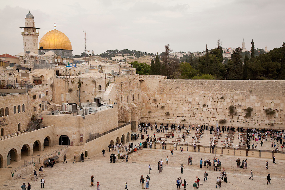 Middle East, Israel, Jerusalem, Jewish worshippers in prayer at Western Wall, with Dome of the Rock in the distance