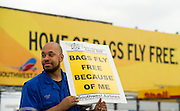 Southwest Airlines employee Chad Pierce stands outside of Dallas Love Field in protest of proposals to outsource some jobs, among other complaints, on Thursday, March 28, 2013. (Cooper Neill/The Dallas Morning News)
