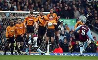Photograph: Scott Heavey, Digitalsport<br /> Aston Villa v Wolverhampton Wanderers. FA Barclaycard Premiership. 14/12/2003.<br /> Juan Pablo Angel fires a free-kick in to the Wolves wall