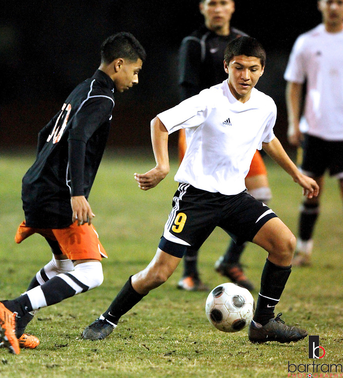 Antioch High's William Lopez, right, tries to get past Pittsburg High's Isreal Murgia during their game at Antioch High School on Tuesday, Feb. 7, 2012. (Photo by Kevin Bartram)