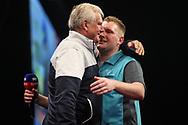 Ryan Harrington is congratulated by his dad Rod Harrington during the Grand Slam of Darts, at Aldersley Leisure Village, Wolverhampton, United Kingdom on 11 November 2019.