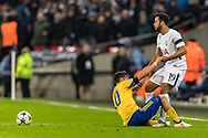 Tottenham Hotspur midfielder Mousa Dembele helps Juventus forward Paulo Dybala to his feet after a tackle during the Champions League match between Tottenham Hotspur and Juventus FC at Wembley Stadium, London, England on 7 March 2018. Picture by Toyin Oshodi.