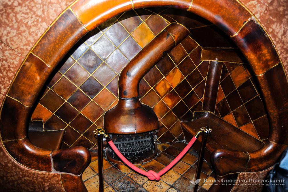 Spain, Barcelona. Casa Batlló is one of Antoni Gaudí's masterpieces. The fireplace.